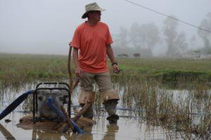 Working the water pump in Vietnam